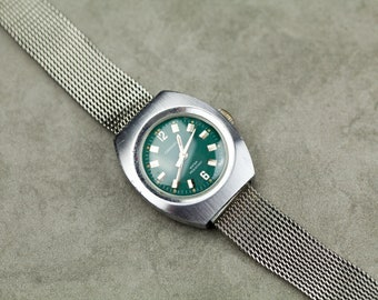 Vintage Caravelle by Bulova Wind Up mechanical womens watch smaller size with green teal colored dial