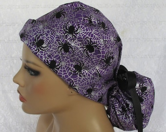 Halloween ponytail scrub hat with spiders and spider webs.  Handmade in the USA.