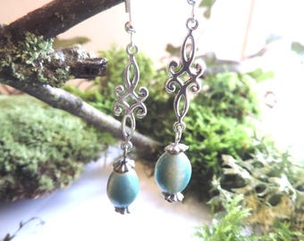 Earrings baroque silver tracery, Blue ceramic oval bead.