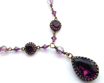 Purple crystal pendant necklace, antiqued brass chain, bezel set rhinestones teardrop pendant. Austrian crystal vintage style purple jewelry