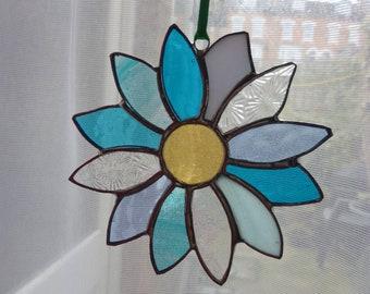 Flower suncatcher. Stained glass flower. Blue flower.