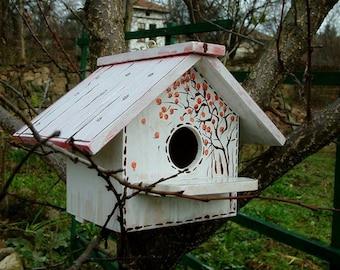 Blue wooden bird houses