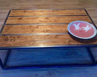 Metal framed steel coffee table with aged wood