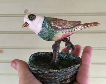 Folk art primitive bird on a limb wall sculpture