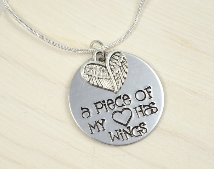 A piece of my heart has wings hand stamped memorial necklace. Loss of children memorial.