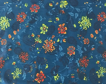 1034/ 100% Cotton print floral fabric of blue, pumpkin orange, and chartreuse green for apparel and quilting