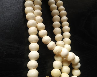 Carved bone bead necklace brass clasp