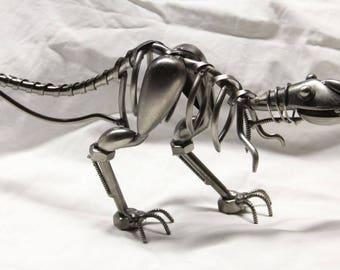 Miniature T-rex dinosaur novelty figurine.  All metal