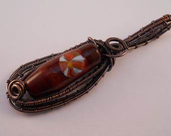 Wrapped & woven oxidized copper wire and lampwork bead pendant in tones of brown with red gray  cane decoration