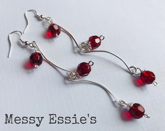 Faceted red glass and silver plated wire drop earrings