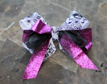 Rock n Roll purple shimmery hair bow with clip musical instruments
