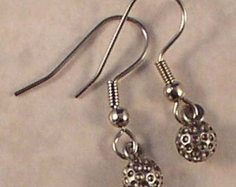 Pewter golf ball earrings on surgical steel french wires.