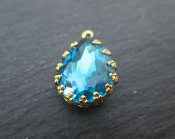 Brass 22 mm with faceted aquamarine cabochon pendant