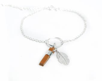 Sterling silver bracelet with feather and leather tassel