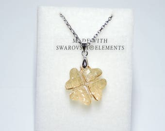 Four Crystal heart clover necklace.