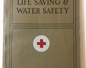 The American Red Cross Life Saving & Water Safety.  Vintage book circa 1956.  Wonderful reference / text book.  1950s Book lover gift.