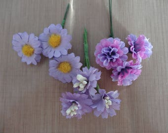3 sets of 3 different flowers in shades of purple