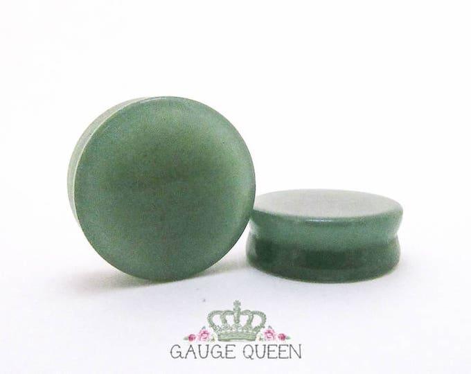 "Natural Jade Stone Plugs / Gauges. 2g /6.5mm, 0g /8mm, 00g /10mm, 1/2"" /12.5mm, 9/16"" /14mm, 5/8"" /16mm, 3/4"" /19mm, 7/8"" /22mm, 1"" /25mm"