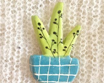 Broche plante verte et bleue en céramique
