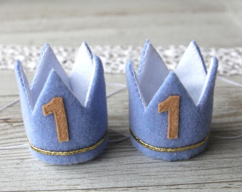 Twin baby boys 1st birthday crowns for first birthday photo shoots - Two blue 1st birthday crowns as a photo prop in a cake smash - Twins