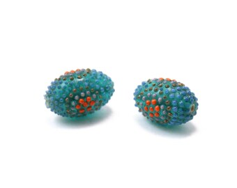 Teal Barrel Bead with Raised Dots of Orange Purple and Bronze 27x19mm 1 piece