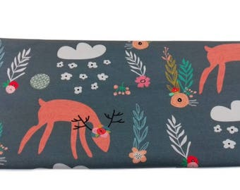 Fabric Jogging deer in a gray forest | Per Metre