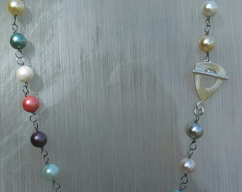 8 mm multi colour shell pearl hand linked, 18 inch necklace with toggle clasp.