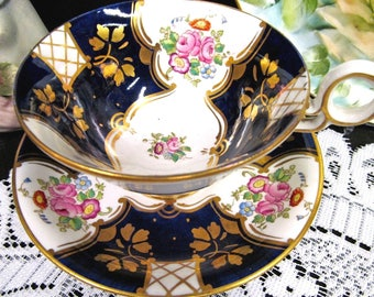 Radfords tea cup and saucer Batwing floral pattern teacup cobalt blue footed