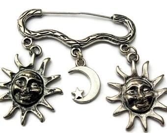 Sun and moon silver tone brooch/pin