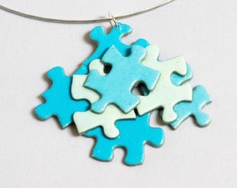 Assembly of blue puzzle pieces pendant