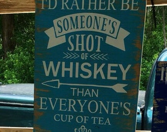 I'd rather be someones shot of whiskey than everyones cup of tea quote bar sign