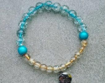 Ocean inspired beaded bracelet with charm