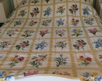 A large French double Quilt.