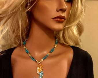 Blonde mermaid w blues and gold pendant necklace 16&1/2 inches w crystals