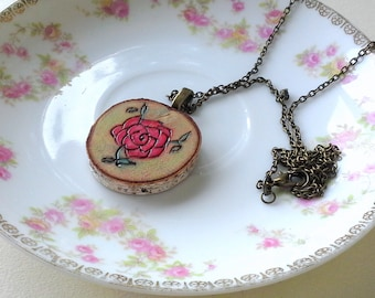 Rose woodburned live edge birch pendant necklace, round wood slice, reds, pinks and green colors, brass chain, nature and garden lover