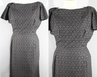1960s Black Cotton Eyelet Wiggle Dress by Manford, Medium to Large   60s Vintage Black Dress (M, L, 40-29-41)