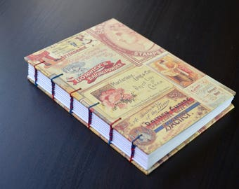Handmade journal with coptic two-colored stitch, covered in Italian vintage paper
