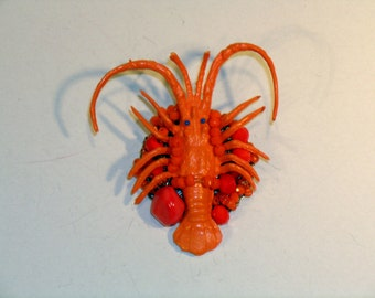 Sea brooch, orange lobster