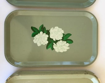Vintage gardenia flowers on a green metal Han - D party serving tray
