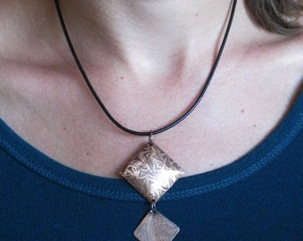 Geometrical composition with organic texture - One of a kind handmade composition in Copper on a black leather cord