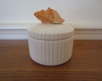 Fitz and Floyd style round porcelain trinket box topped with a coral shell.  Nautical decor.