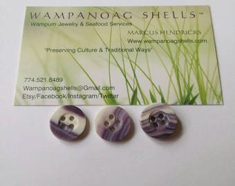 1 Wampum button with four holes
