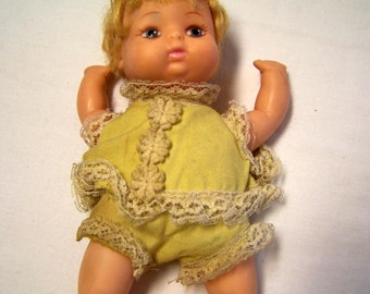 Uneeda baby doll in yellow outfit