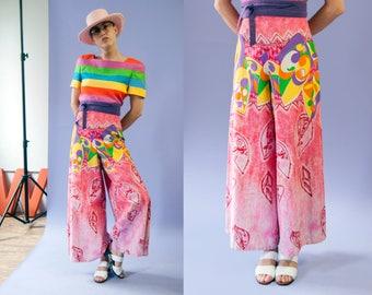70s Green Castle pink neon tiki batik print high waisted palazzo pants | size medium-large (M/L)