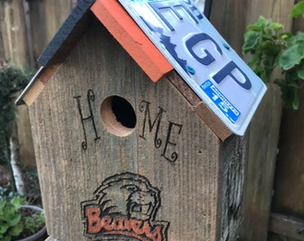 Birdhouse made with Recycled Fencing and Recycled Liscene Plates