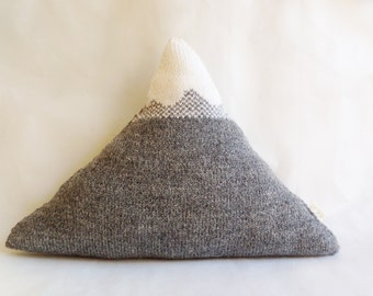 Knitted mountain pillow