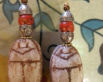 Large carved scarab earrings