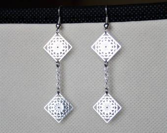 Earrings with silver metal prints