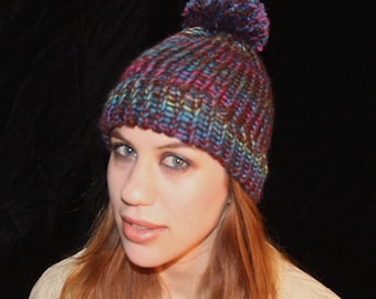 Pompom Hat in Brown, Turquoise, and Muted Rainbow