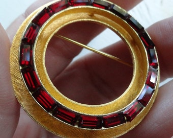 Vintage lovely circle brooch with baguette cut deep red glass stones